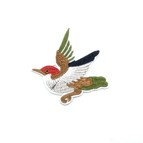 Aplikacja do naprasowania na ubranie - przedstawia lecącego ptaka.