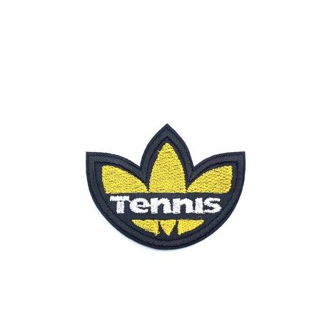 Naszywka sportowa w kolorze żółtym do przyprasowania na ubranie