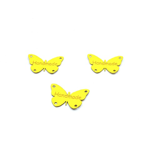 Naszywka z ekoskóry żółta we wzorze motyla. Delikatna ozdoba odzieżowa.