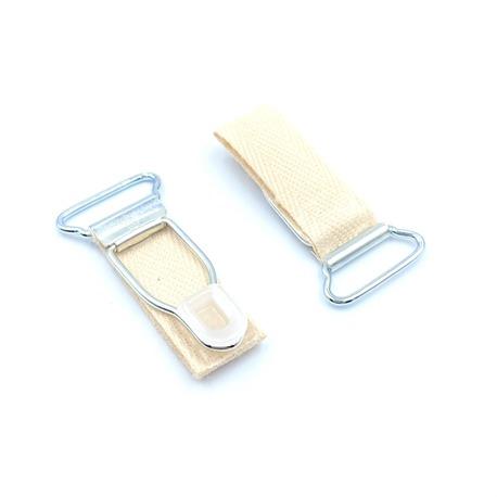 Żabka metalowa do zapinania pończoch z beżową tasiemką i otworem 18mm.