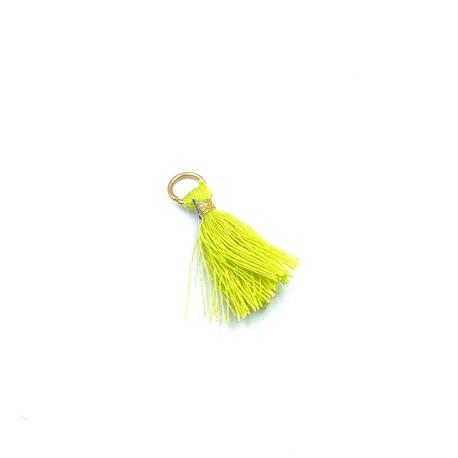 Mały chwost ozdobny w kolorze limonkowym, świetna dekoracja odzieży i torebek damskich.