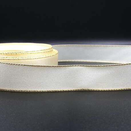 Wstążka ze złotą metalizowaną nitką. Atłasowa wstążka jest bardzo popularną ozdobą, wykorzystywaną podczas okolicznościowych przyjęć.