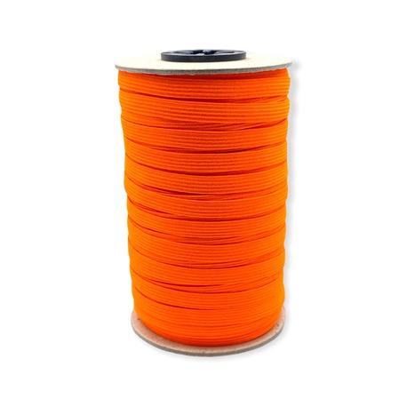 Pomarańczowa gumka bieliźniana wykorzystywana w odzieży o szerokości 7mm.