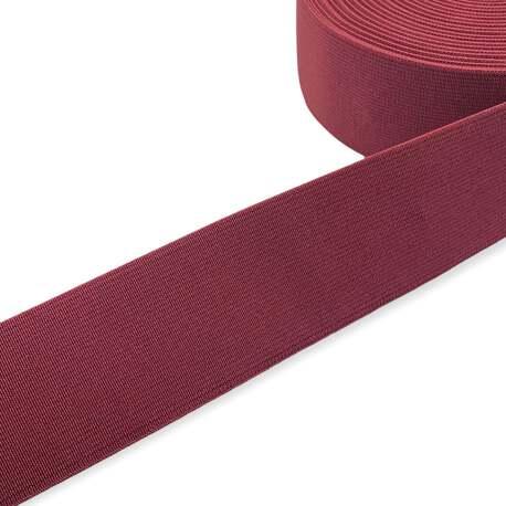 Tkana guma odzieżowa - twarda taśma elastyczna w kolorze bordowym.