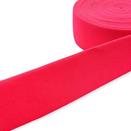 Guma tkana odzieżowa w kolorze różowym fluorescencyjnym do pasków i toreb.