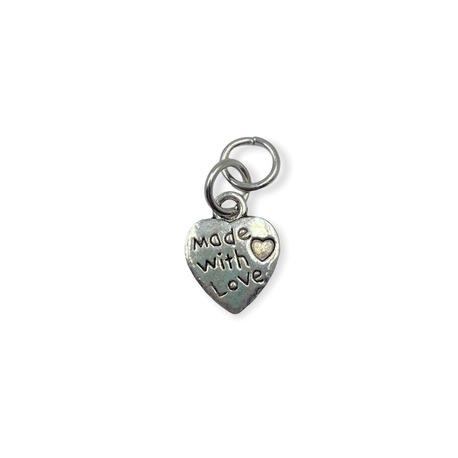 Zawieszka ozdobna z metalu z sercem i napisem.